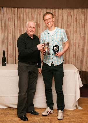 Liam Gutcher receiving the trophy for his 3rd Mens Northern Squash Club Championship